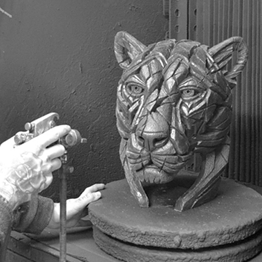 Spray booth with a Panther being sprayed